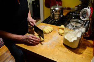 Cut the raised dough into pieces