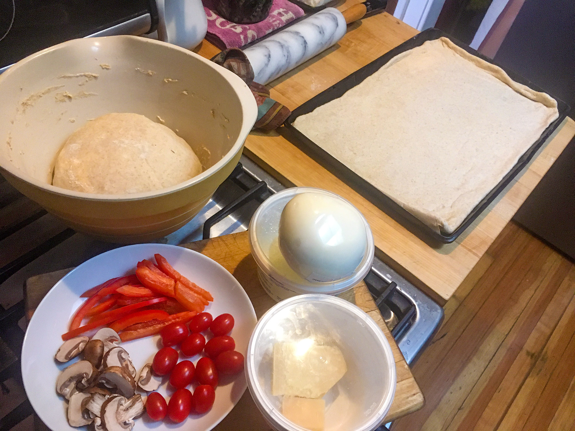 Pizza ingredients and remaining dough